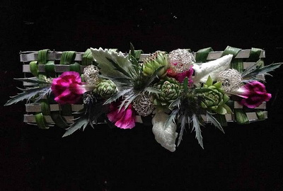 6389e7d0da Rand Powell of Foley s Florist created this inspiring prom cuff   This is  the year of the trendy prom cuff  says Powell. See how this piece was  designed at ...
